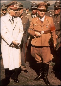 Bormann alongside Hitler during an inspection